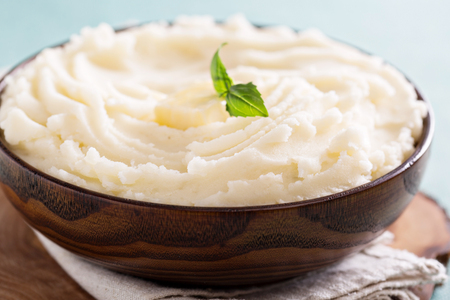 prepared potato: Mashed potatoes in a big wooden bowl
