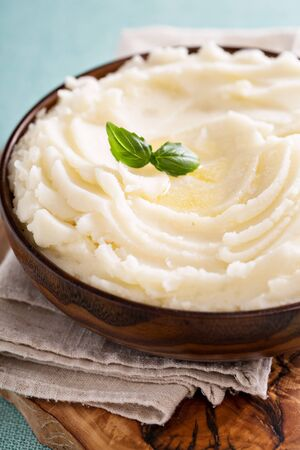 Mashed potatoes in a big wooden bowl