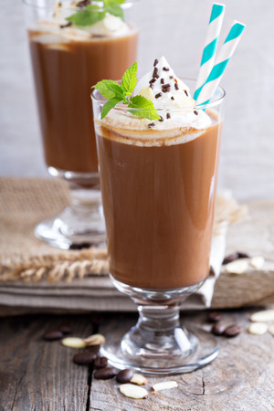 cold: Cappuccino in a glass with whipped cream and almond milk Stock Photo