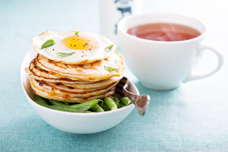 savory: Savory cheddar cheese pancakes with egg on top for breakfast