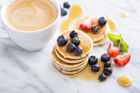 silver maple: Stack of small pancakes with fresh berries and syrup