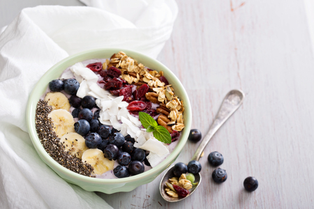 Smoothie bowl with chia, banana, blueberry and coconut Reklamní fotografie - 49632660