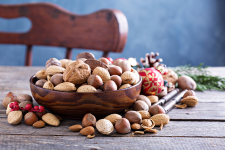 variety: Variety of nuts with shells in a brown bowl