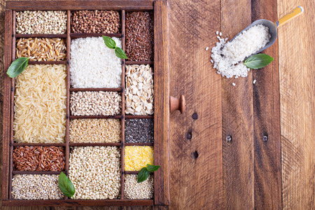 wild oats: Variety of healthy grains and seeds in a wooden box