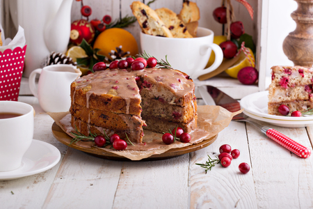 Orange and cranberry christmas cake with cinnamon glaze Stock Photo