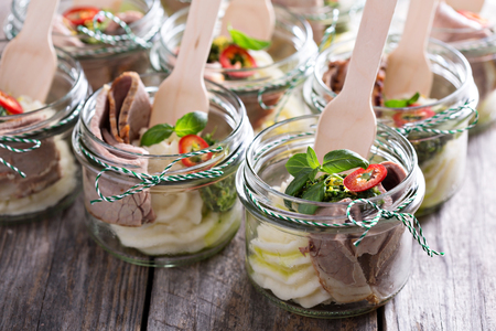 picnic food: Roastbeef with mashed potatoes in small jars for a picnic