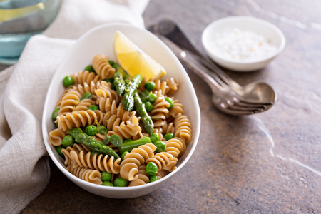 Whole wheat pasta with green peas and asparagus