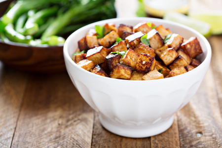 fried rice: Stir fried tofu in a bowl with sesame and greens