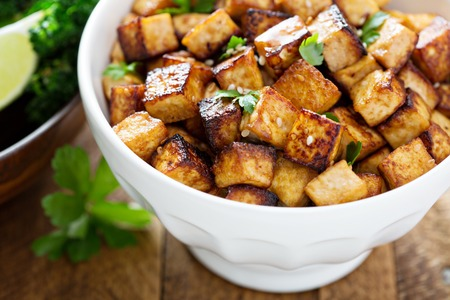 baked beans: Stir fried tofu in a bowl with sesame and greens