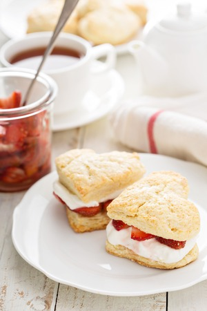 Strawbbery shortcakes with whipped cream and fresh berries