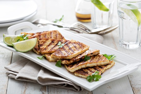 beancurd: Grilled fried tofu  on a plate with sesame and greens Stock Photo
