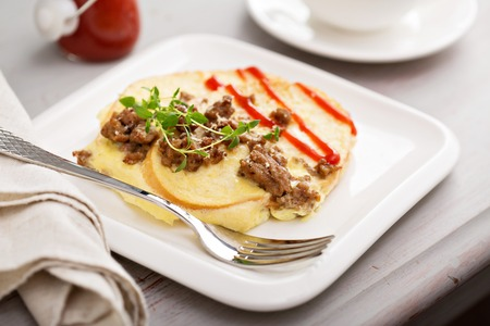 savory: Savory french toast with egg, hot sauce and sausage
