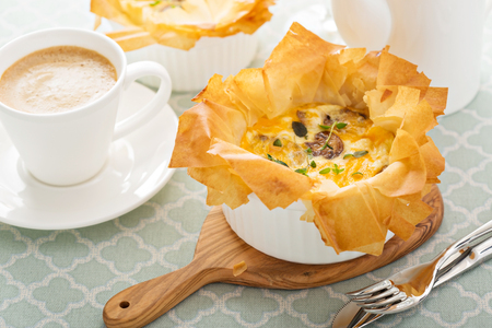 filo pastry: Mushroom and ham quiche with filo pastry Stock Photo