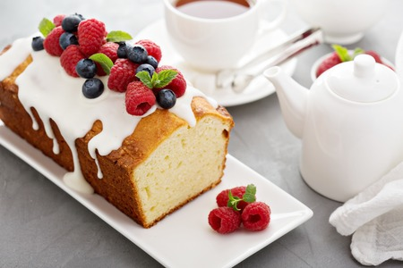 cakes and pastries: Yogurt pound cake for breakfast with glaze and fresh berries