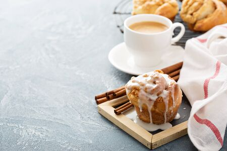 Cinnamon bun for breakfast with vanilla glaze