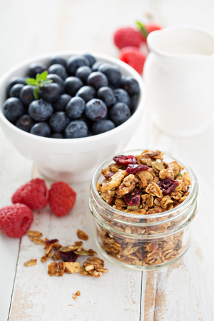 Homemade granola with nuts and seeds in a glass jar
