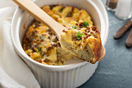 strata: Breakfast strata with cheese and sausage in baking dish