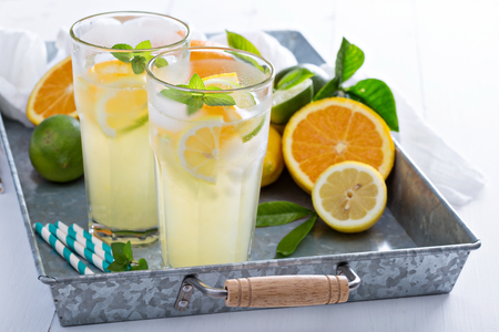 Citrus lemonade with oranges and lemon in tall glasses Stok Fotoğraf