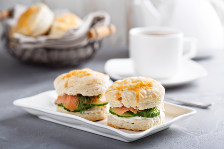 Homemade biscuits with cream cheese, salmon and cucumber