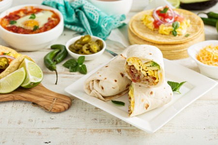 eggs and bacon: Breakfast burritos with eggs, bacon and potatoes