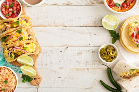 baked beans: Variety of colorful mexican cuisine breakfast dishes on a table Stock Photo