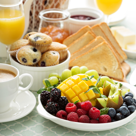 Fruit plate: Fresh and bright continental breakfast table with fruit plate