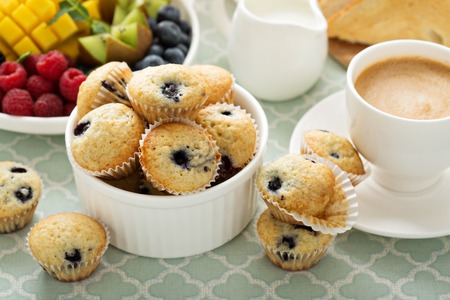 continental: Fresh and bright continental breakfast table with blueberry muffins