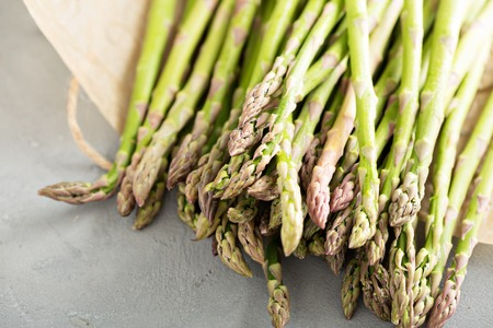 stalk: Fresh green raw asparagus stalks on the table