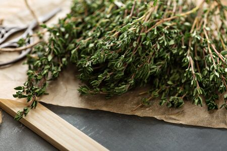 Bunch of fresh aromatic thyme on the table