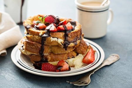 mascarpone: French toast tiramisu with coffee and mascarpone filling and strawberries Stock Photo