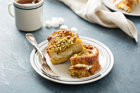 French toast with cream cheese and peach filling and pistachios