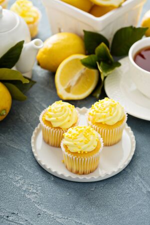 Lemon cupcakes with bright yellow frosting and sprinkles 写真素材