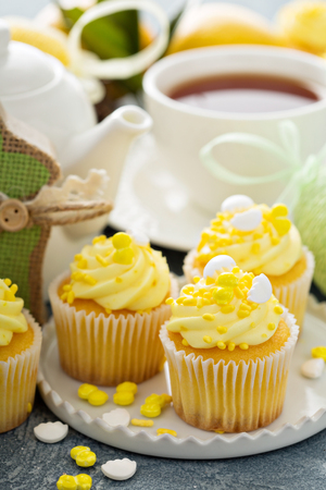 Lemon cupcakes for Easter brunch with yellow frosting and sprinkles