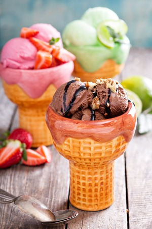 custard flavor: Variety of ice cream in bowls chocolate, strawberry and lime