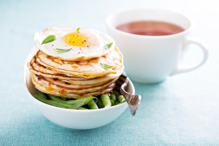 Cheese pancakes with green beans and fried egg