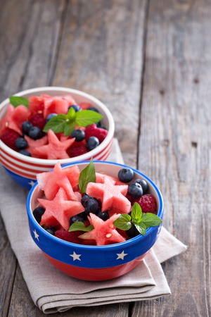 Fruit salad with watermelon shaped as stars and blueberries Banco de Imagens