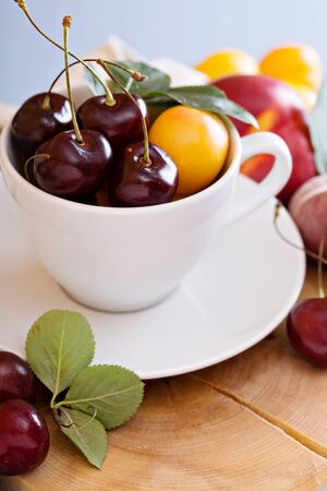 Summer ruits and berries in a cup with apricots and cherries Banque d'images