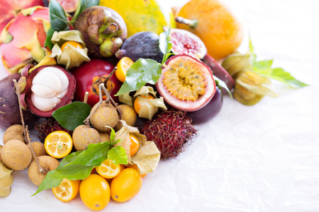 exotic fruits: Exotic fruits on white  with kumquats and figs Stock Photo