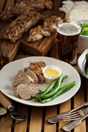 braided: Grilled braided pork with green beans and honey mustard sauce
