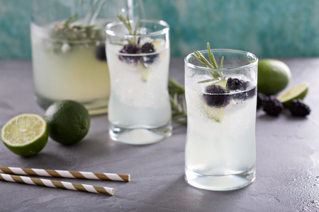 Blackberry lime and rosemary refreshing lemonade in tall glasses