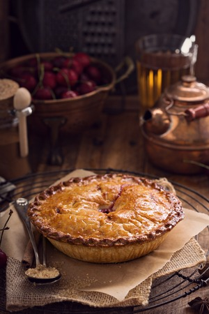 Cherry pie with cinnamon and brown sugar on rustic background Stok Fotoğraf - 58703633