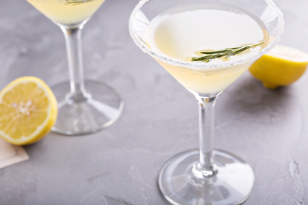 Lemonade martini with rosemary on gray background Stok Fotoğraf