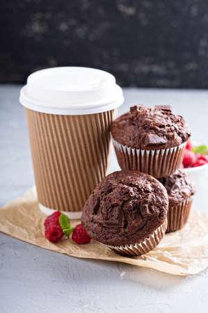 go for: Chocolate muffins with coffee to go for breakfast Stock Photo