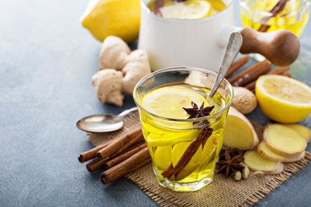 cold remedy: Hot ginger tea drink with lemon - natural medicine remedy for cold days Stock Photo