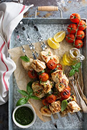 Chicken kabobs with tomatoes and zucchini on a tray