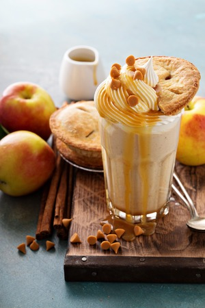 Apple pie milkshake with whipped cream and caramel syrup