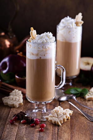 macchiato: Apple cider latte with spices and whipped cream, hot seasonal fall drink Stock Photo