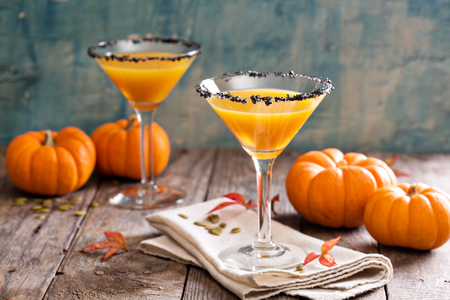 Pumpkin martini fall seasonal cocktail Pumpkintini with black salt rim