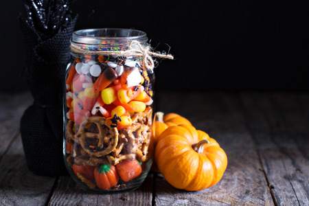 Halloween candy and snacks in a jar on dark background Stock Photo