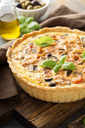 Homemade quiche with chicken and caponata made from eggplant and olives Imagens